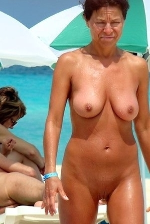busty nudists,mature nudists,nude,on  beach,shaved pussies,women,