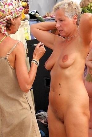 busty nudists,mature nudists,nude,on  beach,
